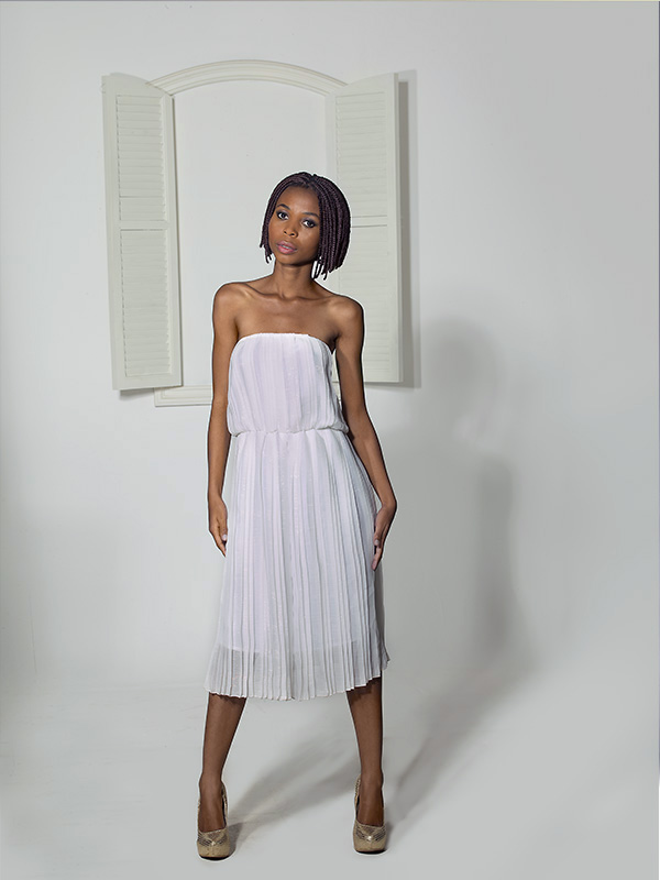 petite black female model in white dress